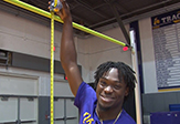 UAlbany Track and Field Athlete Matthew Campbell with a tape measure of his 7-5 jump