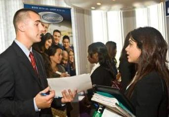 A student talks with a recruiter at a job fair at UAlbany.