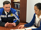 Chatham Police Chief Peter Volkmann and professor Tomoko Udo meet as part of their partnership on the Chatham Cares 4 U program.