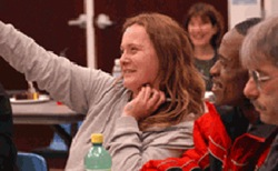 Woman raising hand in a class at COTS.