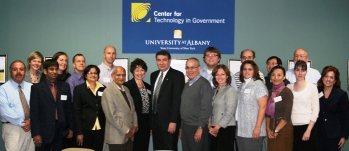 UAlbany President George M. Philip with Center for Technology in Government staff and international faculty
