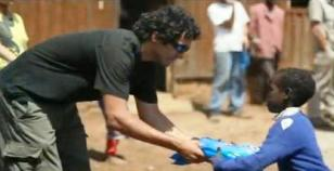 UAlbany MBA student Danny Bocanegra handing out mosquito nets in Africa