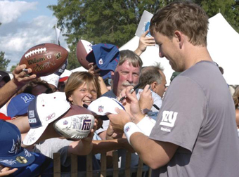 Two-time Super Bowl MVP Eli Manning signs autographs for Giants fans at the University at Albany