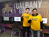 UAlbany eSports teammates Jin Long Shi and Aldair Hernandez inside competitive video-gaming arena at Draper Hall.