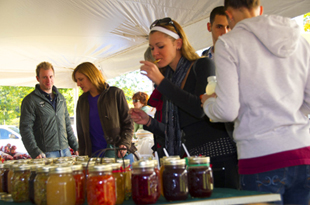 A patron enjoys some samples at the foodtasting during Fallbany in 2010