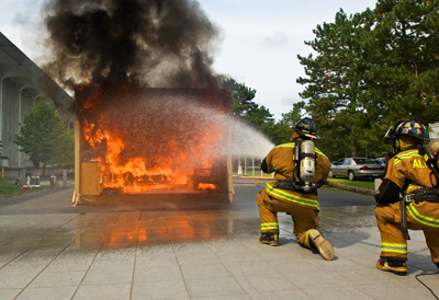 The City of Albany Fire Department douses a UAlbany demo dorm fire in 2009