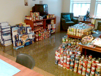 Circle K students stock an apartment full of food ready to deliver for the holidays