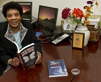 Bailey in her office with two of her books.