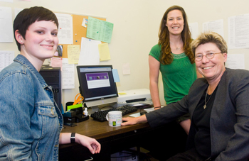 From left , student assistants Sarah Whipple and Lauren Nye, with Writing Center Director Jil Hanifan.