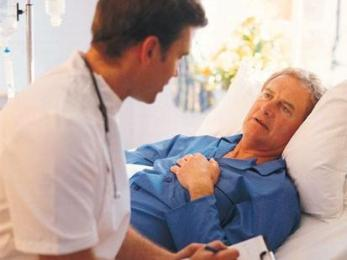 Doctor visits man with chest pains in hospital