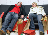 Holiday Shoppers Take a Break on a Sofa