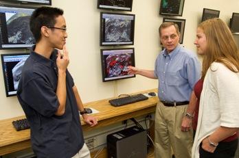 UAlbany student Leon Nguyen, Professor John Molinari, and student Diana Thomas