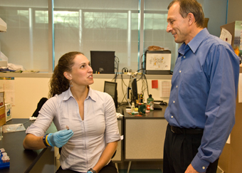 Associate Professor of Chemistry Igor Lednev and former student Kelly Virkler