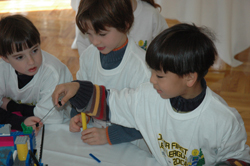 A Junior FIRST Lego League (JFLL) team examines its model