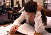 A student at work in UAlbany's Main Library