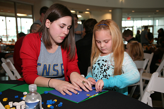 A girl learning about nanotechnology at Nanocommunity Day in 2010