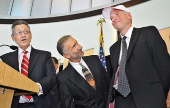 State Assembly Speaker Sheldon Silver and College of Nanoscience and Engineering Senior Vice President and CEO Alain Kaloyeros present Sematech president and CEO Dan Armbrust with an I LOVE NY hat