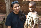 UAlbany senior and TWI President Nishtha Modi with a child in Uganda.