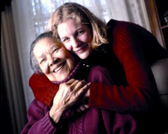 UAlbany social worker supporting older woman, smiling