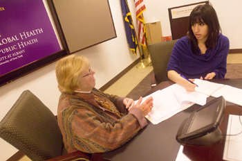 Center for Global Health Director Carol Whittaker plans the conference with Suniah Ayub.