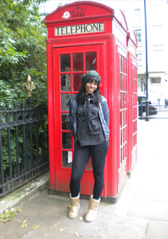 UAlbany public policy major Gina Geffrard in front of a red phone booth in England.