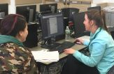 Business MS students assist others during tax season.