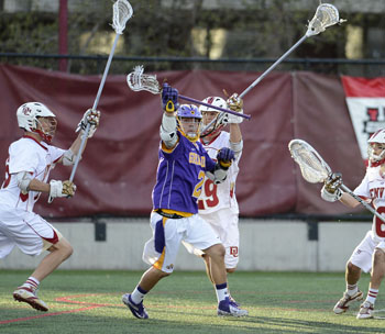 UAlbany's Miles Thompson battles with Denver for the ball