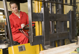 Woman driving a forklift