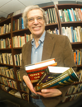 Professor of History Larry Wittner with the three-volume set , The Struggle Against the Bomb.