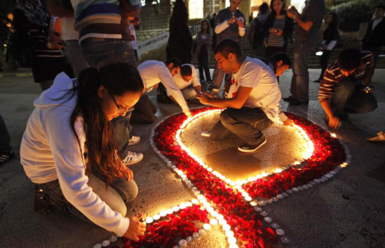 Students prepare a memorial in honor of AIDS victims for World AIDS Day