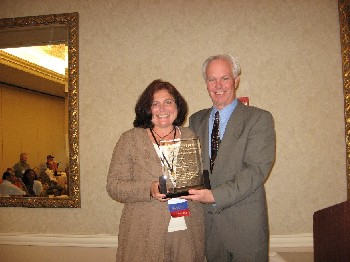 Lianne Fenn, assistant director of Institutional Services, receives the Industry's Leadership Award.