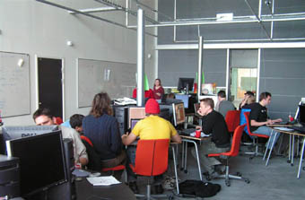 Gamers working on programs and games