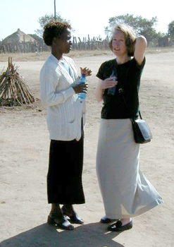 From left, a woman speaks with Case at Agincourt field site, in a rural area in Northeastern South Africa.