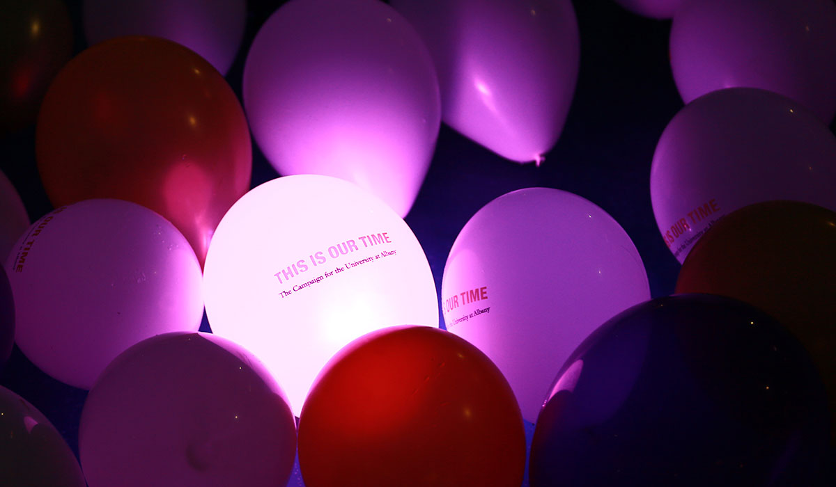 Glowing balloons with This Is Our Time The Campaign for the University at Albany logo