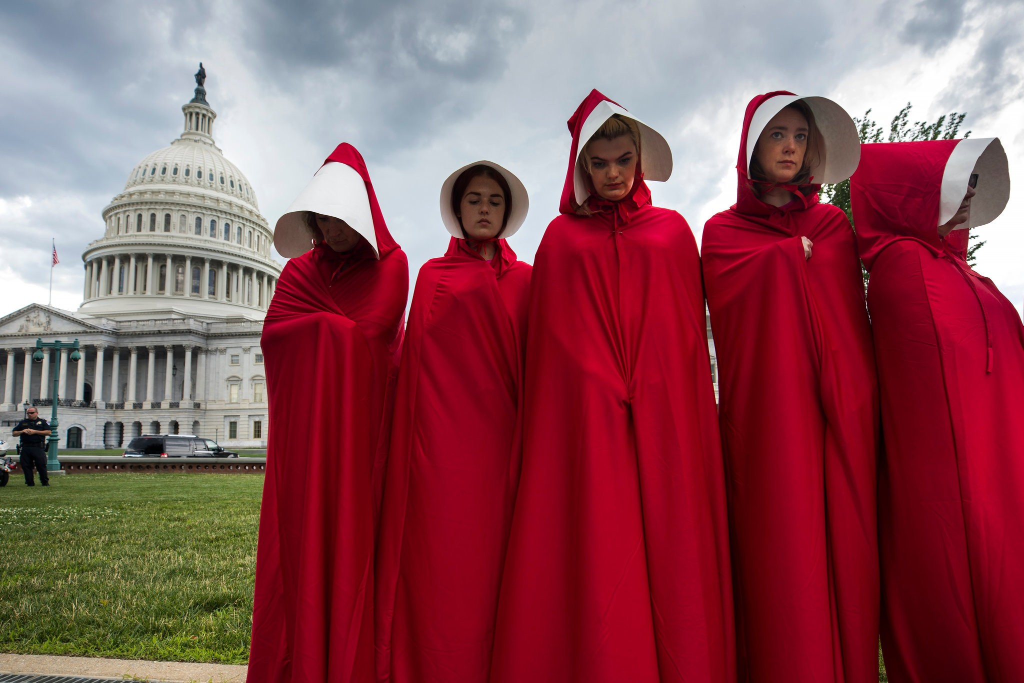 A group of women from A Handmaid's Tale in front of the U.S. Capitol building
