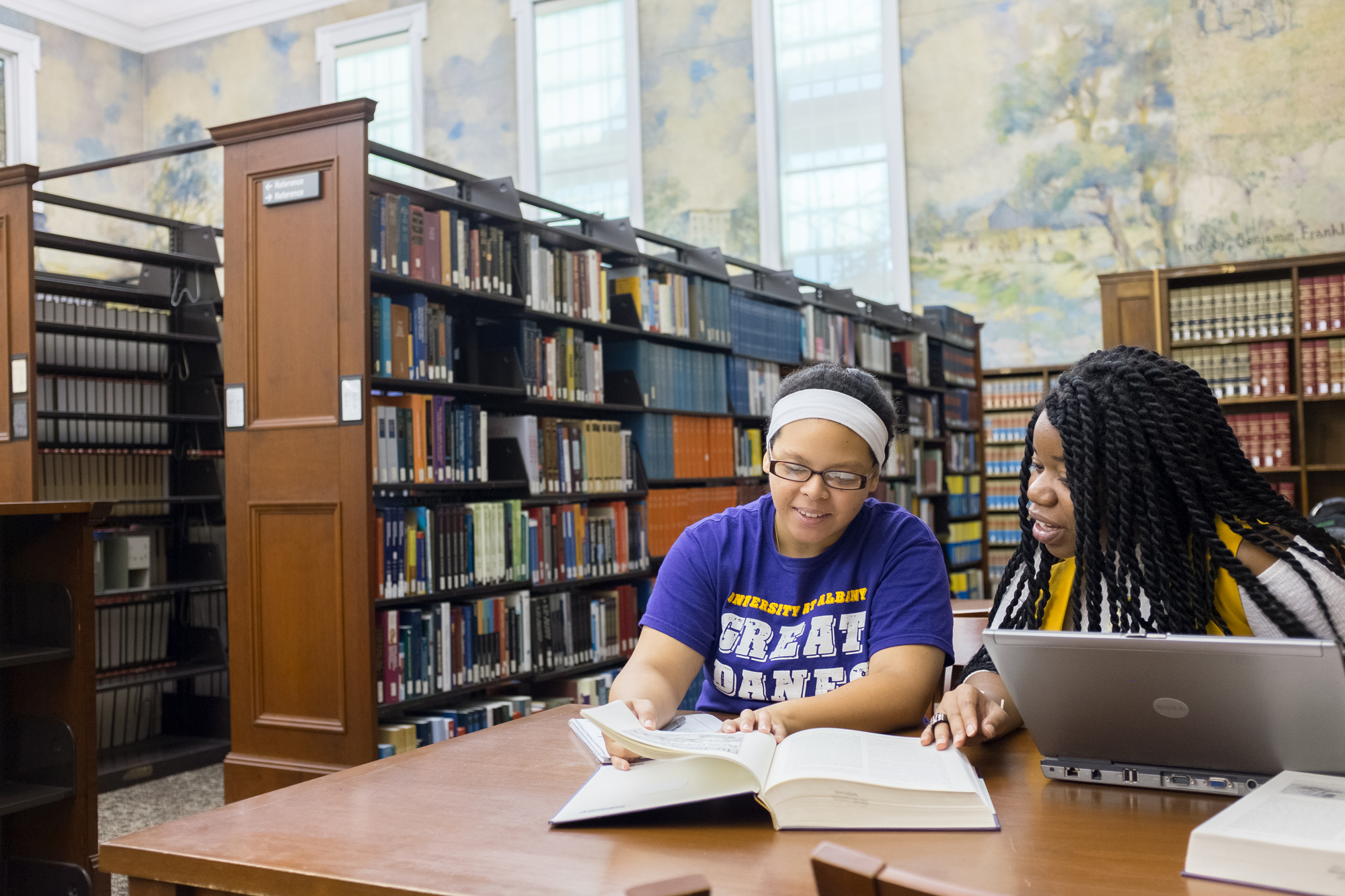 Two students studying in the Dewey Library