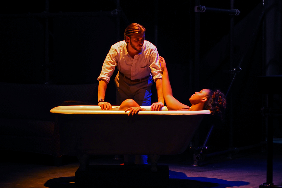 Two students performing in a theatre production