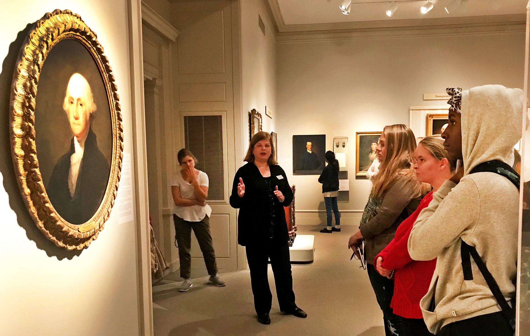 "Students in the class ""Women in Art from the Renaissance to Impressionism "" view the exhibition ""The Schuyler Sisters and Their Circle"" with curator Diane Shewchuk at the Albany Institute of History and Art in Fall 2019"