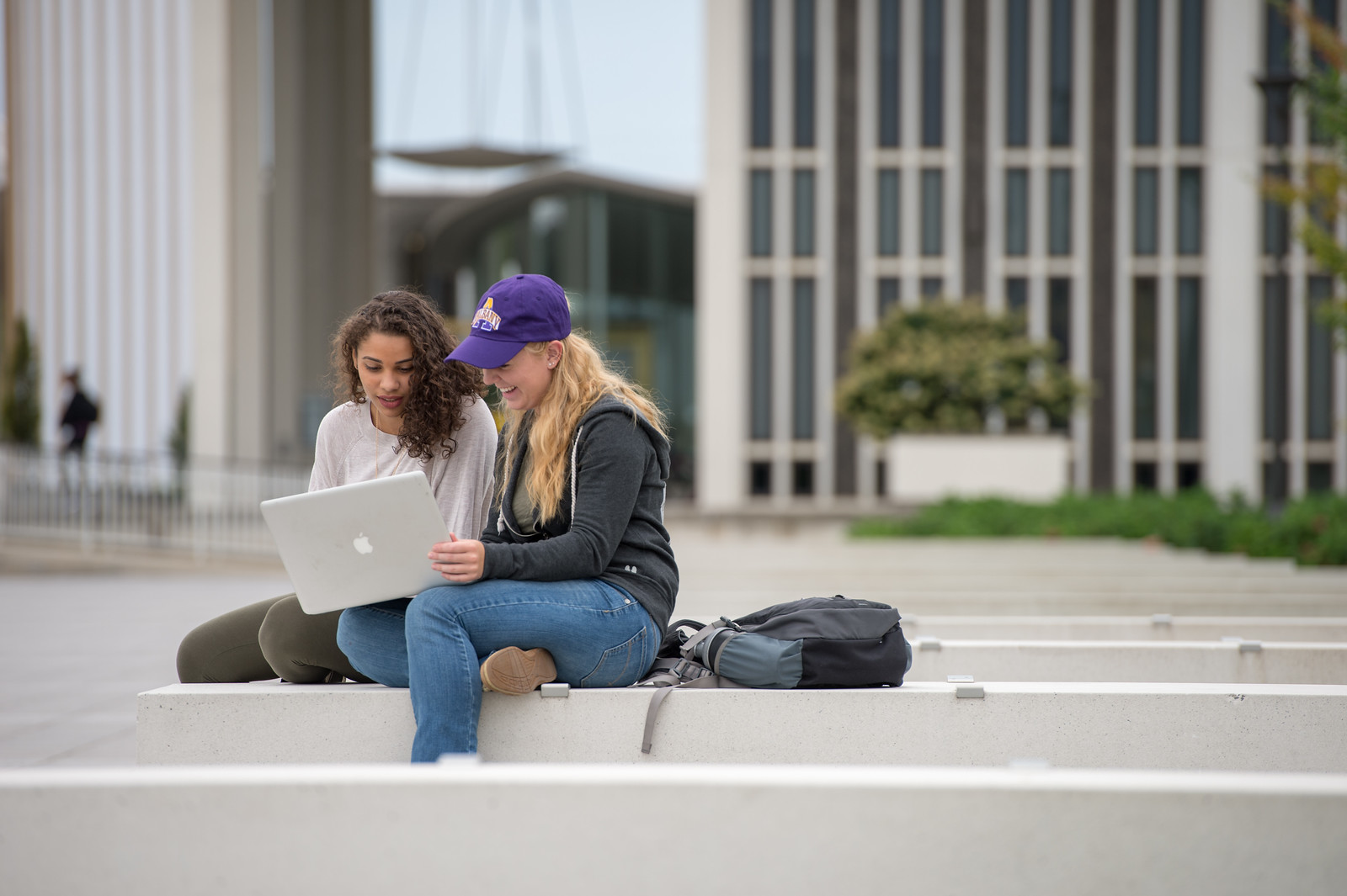 Two students studying on the UAlbany Entry Plaza