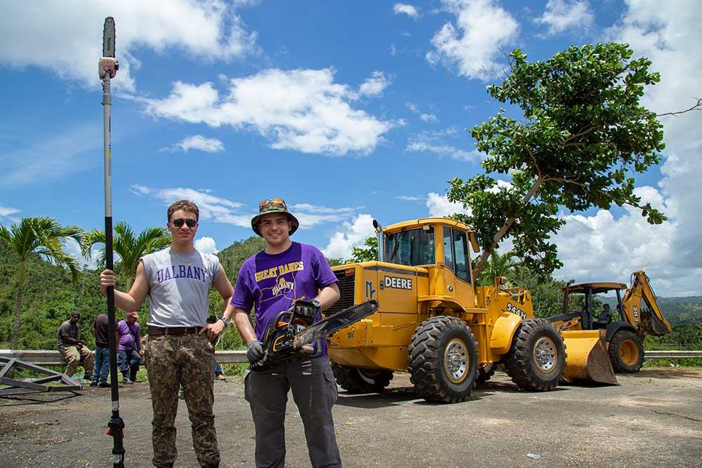 UAlbany CEHC Students help to remove trees.
