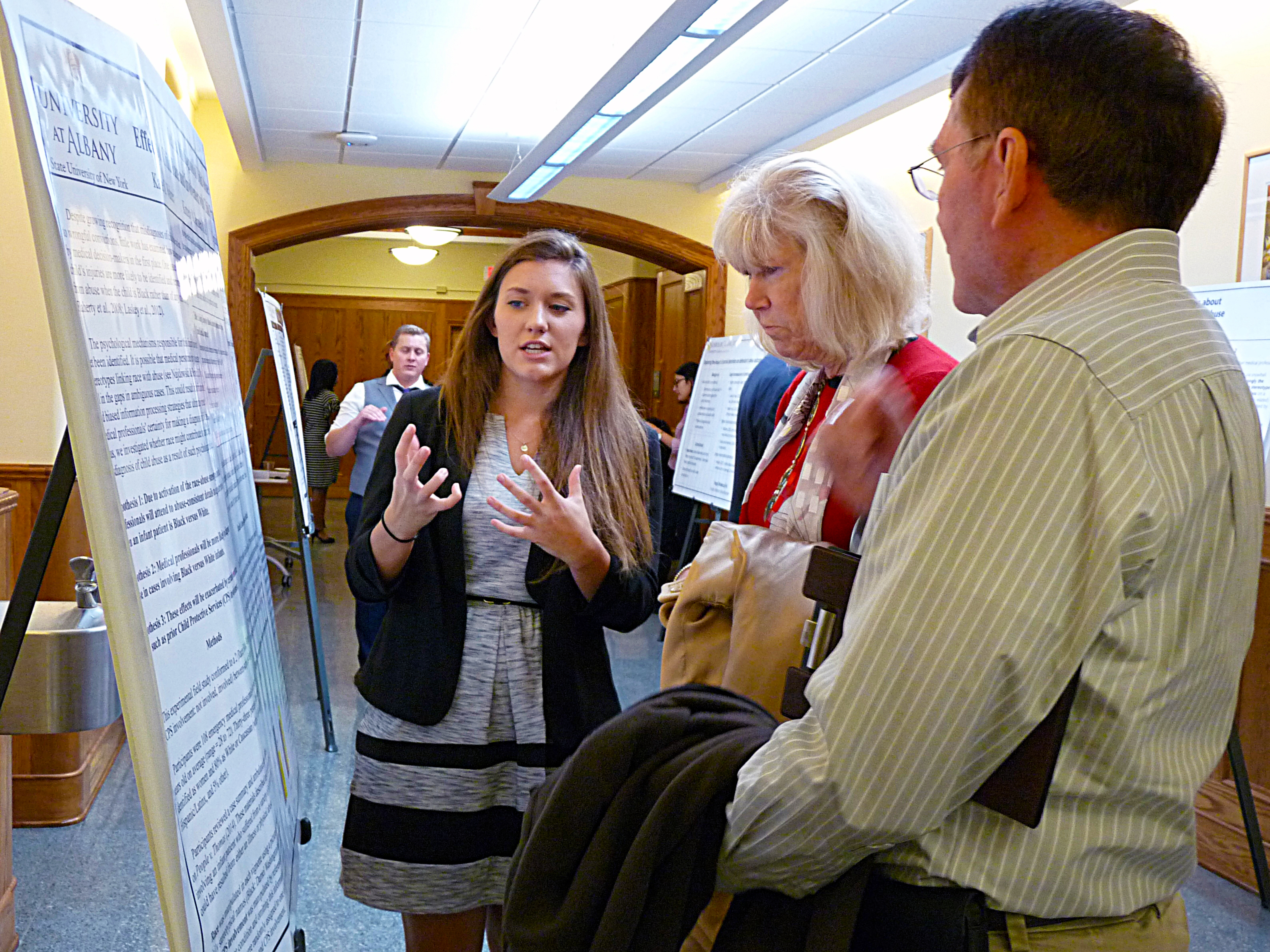 A criminal justice student explains her research during a poster session