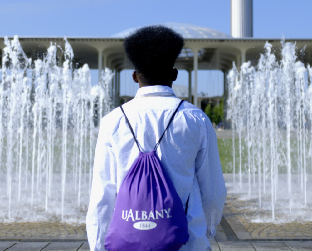 Student walking toward the front of campus.