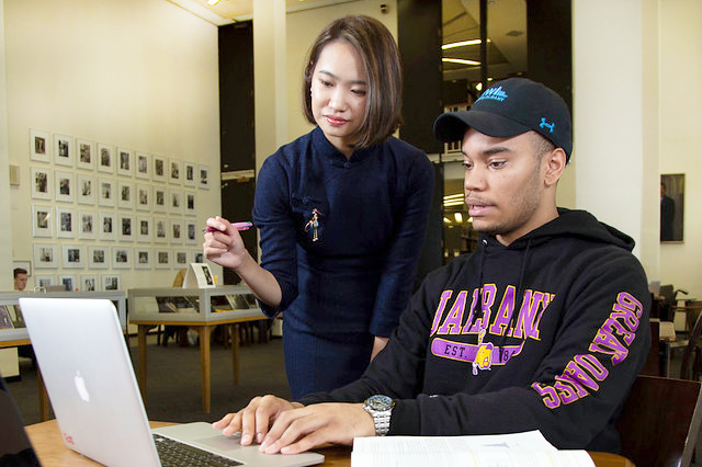 Two students studying in the UAlbany library
