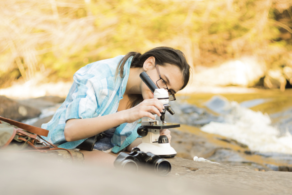 Student working with a microscope
