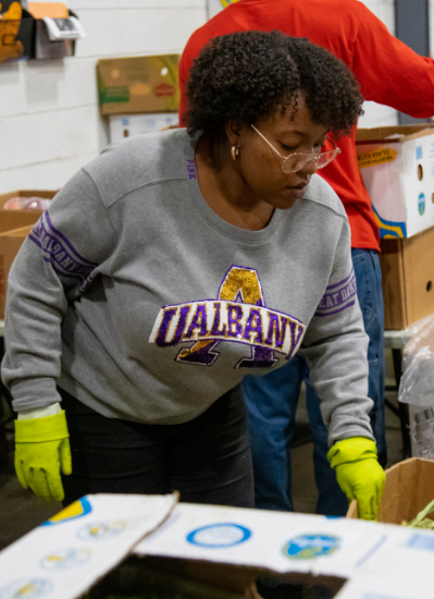 UAlbany student working in local food bank, sorting food