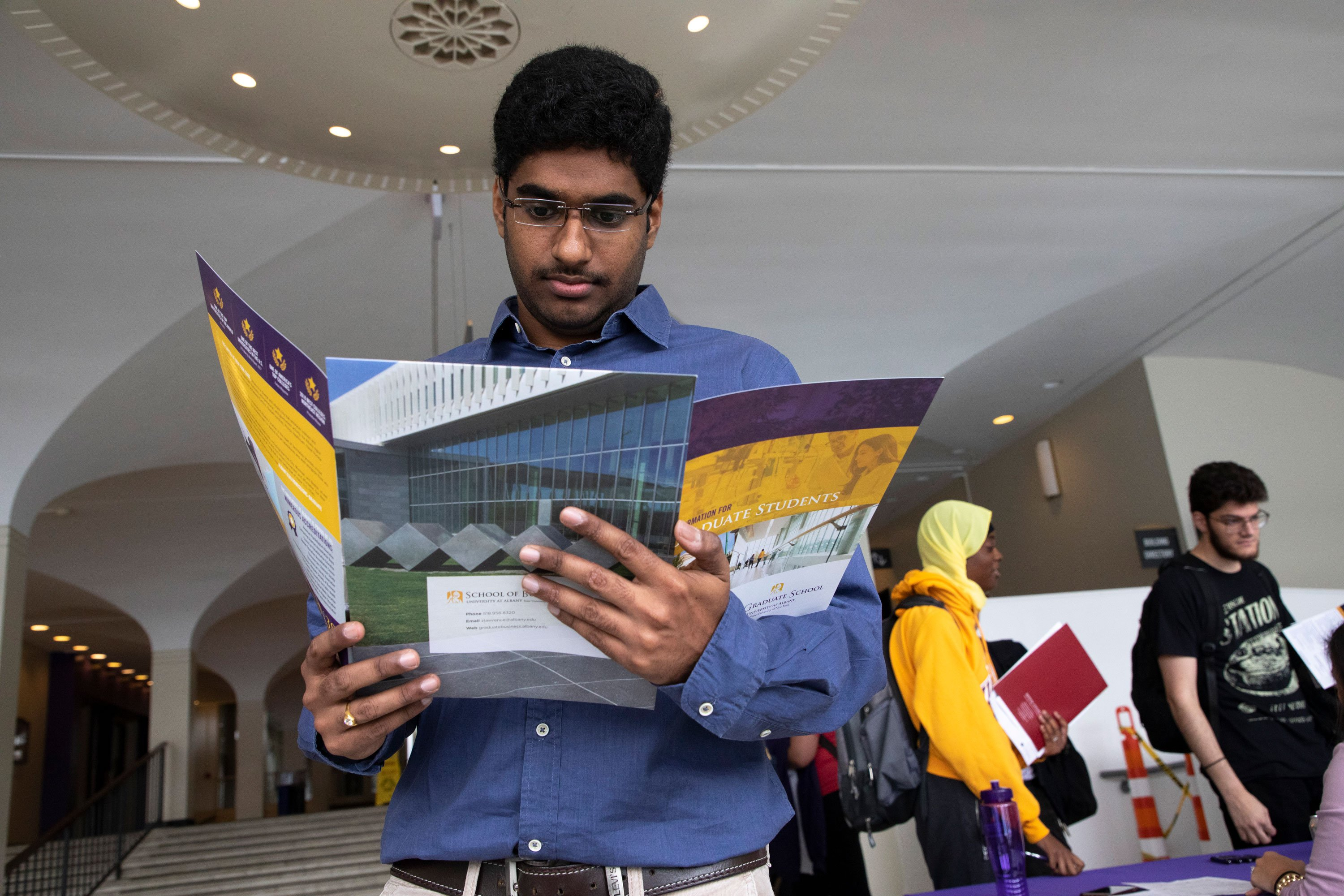A student attends UAlbany's annual Graduate & Professional School Fair on the Uptown Campus.