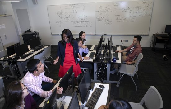 Victoria Kisekka, an assistant professor of information security and digital forensics, trains students in a cyber lab at the School of Business. (Photo by Patrick Dodson)