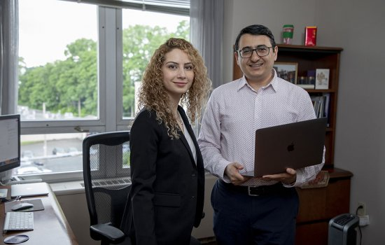 Shaghayegh Sahebi, left, and Reza Feyzi-Behnagh are using a new NSF grant to detect procrastination in online learners and find ways to improve these learners' self-regulation.