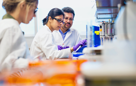 Bijan Dey, at right, works pre-2020 in his lab with an RNA researcher and, at left, a student.