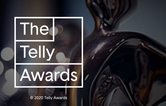 """The Telly Awards"" is written in white on top of a dark background image of a dim gold trophy."